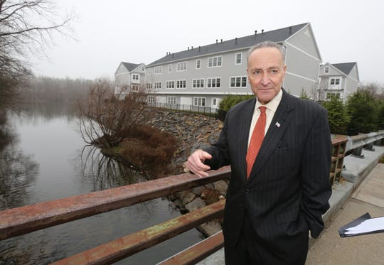 Sen. Charles Schumer, stands on a bridge near the Bowman Avenue Dam in Rye Brook, to call for an immediate and thorough investigation of America's critical infrastructure by the Department of Homeland Security (DHS).