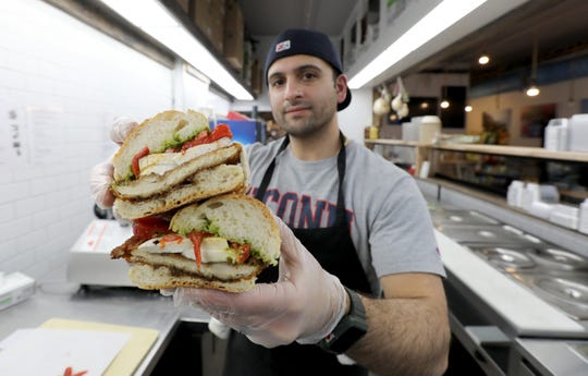 Leonardo's Deli owner  Frank Ficarra will have trays of items for your Easter meal. He's also still offering sandwiches, like the chicken parm one, here.