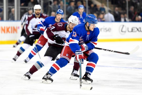 Jan 7, 2020; New York, New York, USA; New York Rangers defenseman Adam Fox (23) skates with the puck against the Colorado Avalanche during the first period at Madison Square Garden.