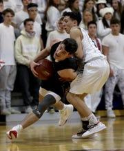 Rye's Matthew Tepedino tangles with Matteo Sinon of Byram Hills during a varsity basketball game at Byram Hills High School in Armonk Jan. 7, 2020. Rye defeated Byram Hills 67-56.