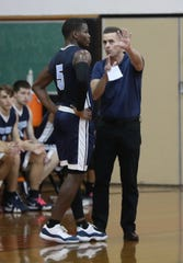 Suffern coach Scott Wright was named the Section 1 Coach of the Year. Wright is pictured with Clevmer Lubin during a game at Spring Valley High School.