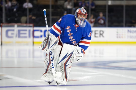 New York Rangers goaltender Igor Shesterkin warms up for the team's NHL hockey game against the Colorado Avalanche on Tuesday, Jan. 7, 2020, in New York. Shesterkin is set to make his NHL debut.