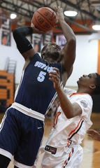 Suffern's Clev Lubin shoots over Spring Valley's Shamar Jackson during their game at Spring Valley Jan. 7, 2020. Suffern won 46-25.