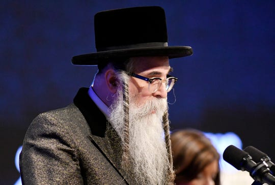 Rabbi Chaim Rottenberg of Congregation Netzach Yisroel, speaks before New York Gov. Andrew Cuomo delivers his State of the State address at the Empire State Plaza Convention Center on Wednesday, Jan. 8, 2020, in Albany, N.Y.
