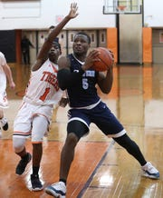 Suffern's Clev Lubin drives to the net during a game at Spring Valley Jan. 7, 2020. Suffern won 46-25.
