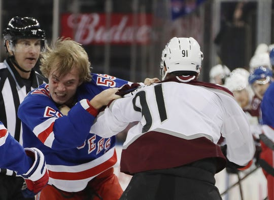 Ryan Lindgren #55 of the New York Rangers fights with Nazem Kadri #91 of the Colorado Avalanche during the first period at Madison Square Garden on January 07, 2020 in New York City.