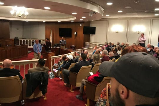 Community members fill city hall for a public meeting about the proposed location for Dover Interfaith Mission for Housing, a men's homeless shelter.