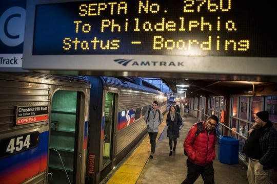 Commuters get on the SEPTA 5:15 afternoon train to Philadelphia at the Wilmington Train Station Wednesday afternoon.