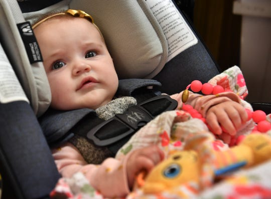 Sadie Hines, four months, sits quietly in her carrier while at work with her mother, Jenny Lee Hines, owner of Jameson's Flowers.