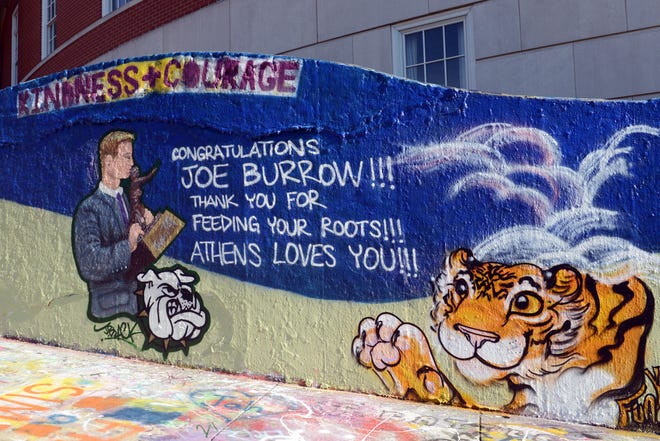 A mural congratulating LSU quarterback and Heisman Trophy winner Joe Burrow was painted on the Ohio University campus in Athens. Burrow, an Athens High grad, raised awareness to the poverty and hunger issues in Athens County with an emotional speech, triggering a nationwide fundraising effort that brought more than $500,000 to the Athens County Food Bank.