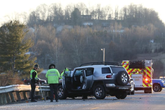 Troopers from the Ohio State Patrol investigate a wreck on State Route 93 near Roseville Wednesday afternoon. A pickup truck went left of center, striking a pair of SUVs, the second headon.