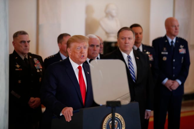 President Donald Trump addresses the nation from the White House on the ballistic missile strike that Iran launched against Iraqi air bases housing U.S. troops, Wednesday, Jan. 8, 2020, in Washington, as Vice President Mike Pence, Secretary of State Mike Pompeo and military leaders, look on.