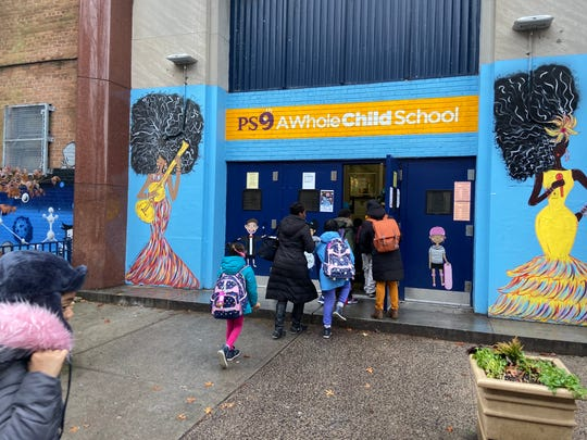 Students enter PS 9 in Brooklyn.