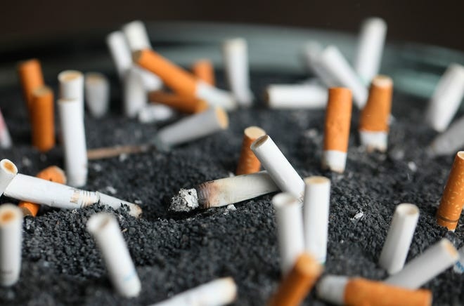 This March 28, 2019 photo shows cigarette butts in an ashtray in New York. On Wednesday, Jan. 8, 2020, researchers reported the largest-ever decline in the U.S. cancer death rate, and they are crediting advances in the treatment of lung tumors. Most lung cancer cases are tied to smoking, and decades of declining smoking rates means lower rates of lung cancer diagnoses and deaths.