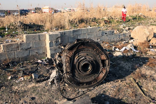 One of the engine of the plane lies among the wreckage after an Ukraine International Airlines Boeing 737-800 carrying 176 people crashed near Imam Khomeini Airport in Tehran, killing everyone on board, in Shahriar, Iran, Jan. 8, 2020.