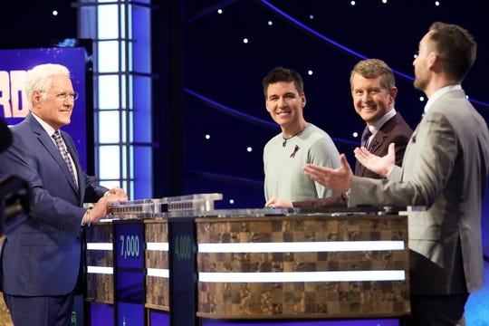 "Alex Trebek interacts with ""Jeopardy!"" legends (from left to right): James Holzhauer, Ken Jennings and Brad Rutter."