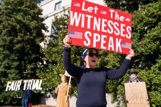 Impeachment demonstrators outside a Senate building on Jan. 6, 2020.