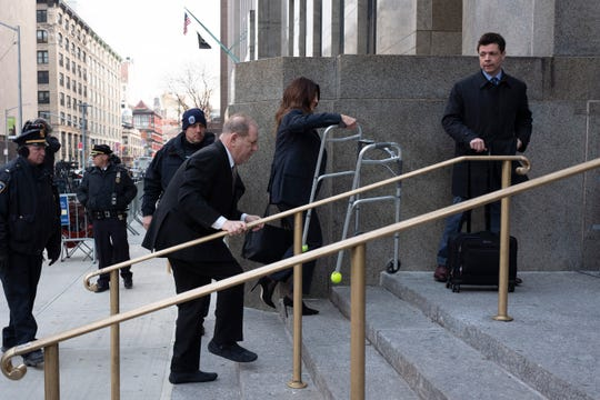 Harvey Weinstein walks up courthouse steps as his attorney Donna Rotunno holds his walker, Jan. 8, 2020 in New York.