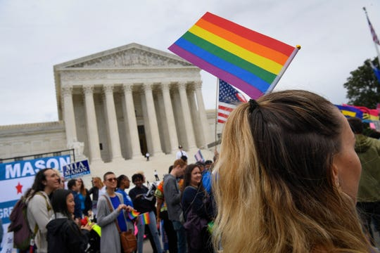 Demonstrators gather in front of the Supreme Court in October as the justices hear challenges involving workers who claimed they were fired for being gay or transgender.