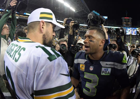 Seattle Seahawks quarterback Russell Wilson (3) shakes hands with Green Bay Packers quarterback Aaron Rodgers (12) after the game at CenturyLink Field.