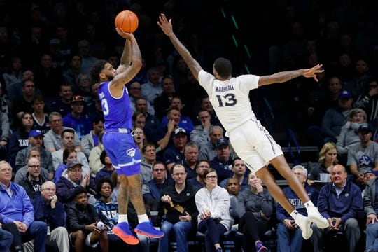 Seton Hall's Myles Powell, left, shoots against Xavier's Naji Marshall (13)