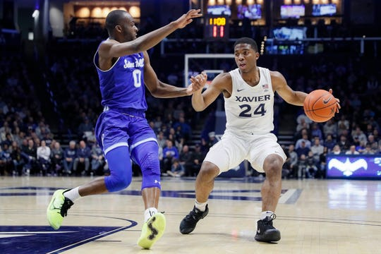 Xavier's KyKy Tandy (24) drives against Seton Hall's Quincy McKnight (0)