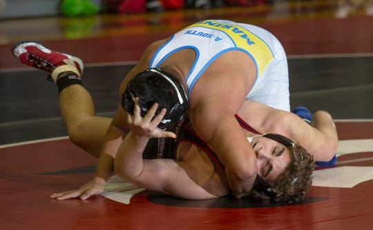 Toms River North's Michael Nakano (top) gets back points against Jackson Memorial's Brad Galassi in the 220-pound bout. Nakano won the bout 5-2. Toms River North won the match 40-17.
