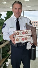 Abilene Police Department Chief Stan Standridge was honored Thursday morning for 25 years of service to the city by the Abilene City Council with 25 doughnuts. There was no word he was sharing.