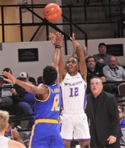 ACU's Mahki Morris (12) shoots a 3-point goal as McNeese's A.J. Lawson defends and Cowboys coach Heath Schroyer look on. Morris missed the only shot he took, while Lawson scored a game-high 35 points.