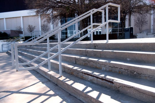 Rusted metal shows through the steps on the north side of the Abilene Convention Center.