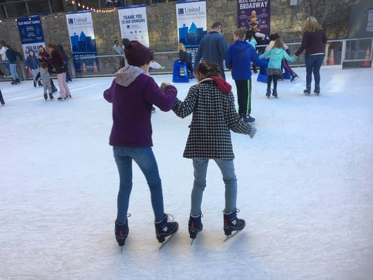 Eloise Guerguerian, left, of Asheville, tries out ice skating for the first time recently at the United Community Bank Ice on Main outdoor skating rink in Greenville, South Carolina. The rink is open through Martin Luther King Jr., Day, Jan. 20.