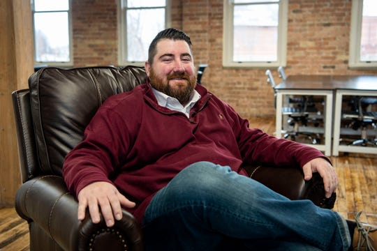 Tyler Rominger, co-owner of Collab BC, hangs out at the office on Thursday, Jan. 9, 2020 in Battle Creek, Mich. Collab BC leases offices and workspaces for startups, freelancers etc.
