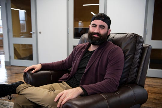 Vincent Rominger, co-owner of Collab BC, hangs out at the office on Thursday, Jan. 9, 2020 in Battle Creek, Mich. Collab BC leases offices and workspaces for startups, freelancers etc.