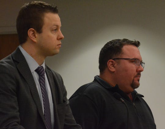 Benjamin Robinson, right, with his attorney Aaron Bartell, was arraigned Thursday.