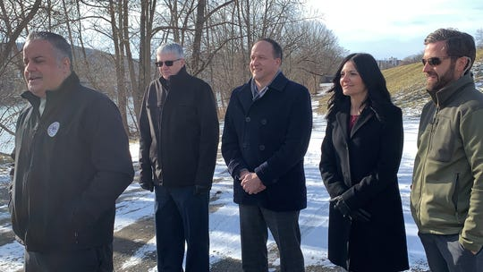 Binghamton Mayor Richard David stands with members of Tetra Tech near the Susquehanna River Thursday, Jan. 9, 2020, to discuss a floodwall and levee project.