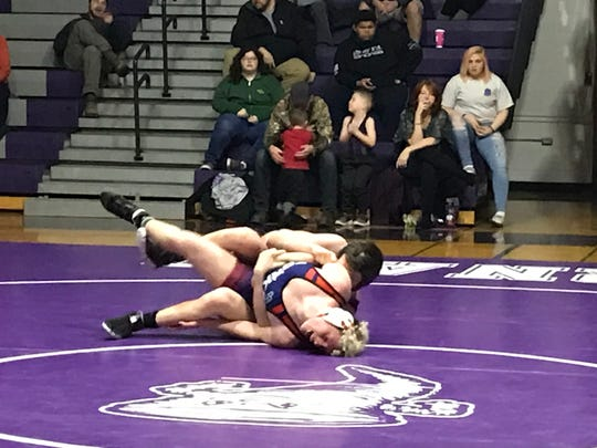 Chenango Forks' Brad Needles, foreground, and Norwich's Mikey Squires wrestle in the 182-pound match during Wednesday's Southern Tier Athletic Conference match at Norwich. Squires won by pin, but Forks won the match, 45-34.