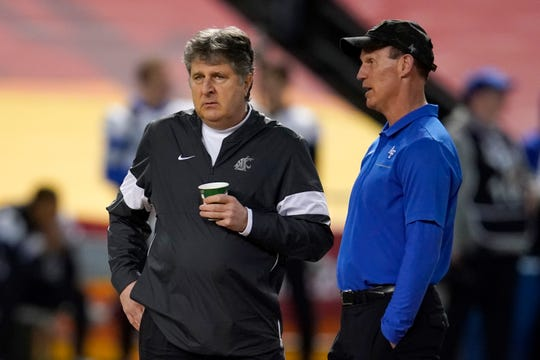 Washington State coach Mike Leach, left, and Air Force  coach Troy Calhoun talk before the Cheez-It Bowl NCAA college football bowl game, Friday, Dec. 27, 2019, in Phoenix.