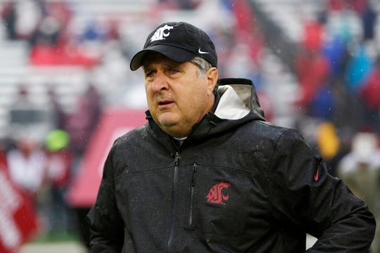 FILE - In this Oct. 19, 2019, file photo, Washington State head coach Mike Leach walks onto the field before an NCAA college football game against Colorado, in Pullman, Wash. Two people with knowledge of the decision says Mississippi State has hired Washington State's Mike Leach as its new head coach.  The people spoke to The Associated Press on condition of anonymity Thursday, Jan. 9, 2020, because the school has not yet officially announced the move. Leach will replace Joe Moorhead, who was fired last week after two seasons.