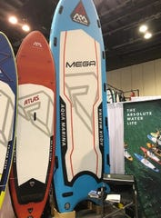 "Aqua Marina's inflatable Mega paddleboard can carry eight to paddlers andis called a ""party board,"" one of the new trends at the 2020 Surf Expo in Orlando."