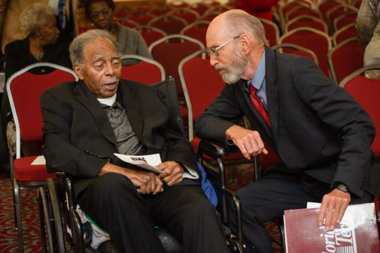 Julius Montgomery and Dr. Gordon Patterson visit together before the start of the Julius Montgomery Pioneer Award and the Dr. Harvey L. Riley Bridge Builder Award presentation in celebration of Martin Luther King Jr. Day. (Photo by Amanda Stratford, for FLORIDA TODAY)
