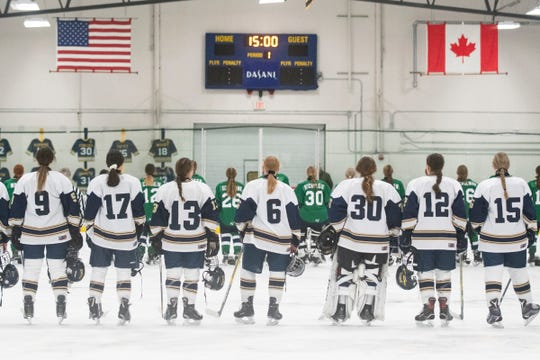 The teams listen to the National Anthem during the girls hockey game between the Burlington/Colchester Sea Lakers and the Essex Hornets at the Essex Skating Facility on Wednesday night January 8, 2020 in Essex, Vermont.