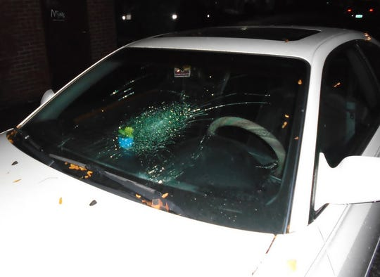 Burlington Police released this photo of damage to a car behind Farmhouse Tap and Grill. In October, they said Justin Reynolds, 32, went on a vandalism spree before assaulting officers when being arrested.