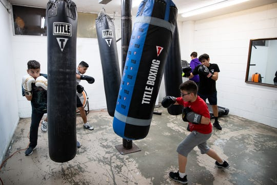 Students uses punching bags as they train at Duke it Out Boxing on Wednesday, Jan 9, 2019.