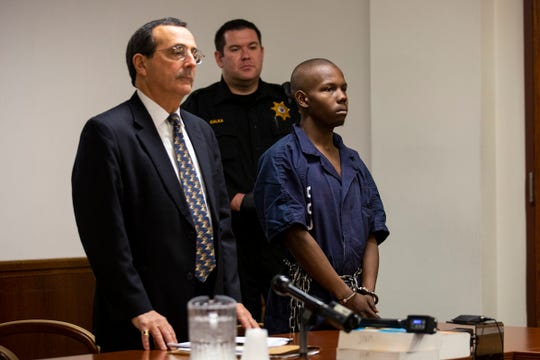 Dyheam Williams, 18, of Lindenwold, N.J., right, who was arrested and charged with murder and weapon offenses in the Friday, Jan. 3, 2020, fatal stabbing of Shamrock Deli owner Jerome Pastore, 57, in Audubon, appears in court with his defense attorney Brad Wertheimer, left, in front of Judge Edward McBride for a  detention hearing at the Camden County Superior Court in Camden on Thursday, Jan. 9, 2020.