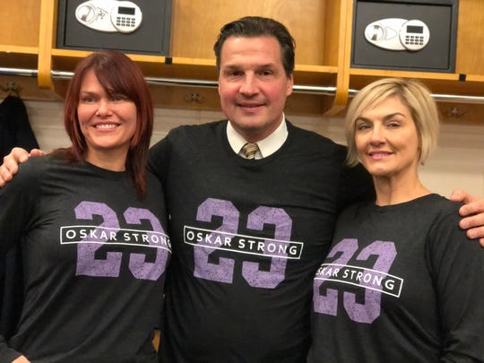 Kim Parent, left, and Jodi Smith, right, have raised more than $200,000 in #OskarStrong t-shirts. Ed Olczyk, center, and a cancer survivor himself, proudly wore his Wednesday.
