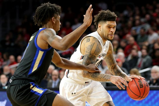 Cincinnati Bearcats guard Jarron Cumberland (34) drives to the basket as Tulsa Golden Hurricane guard Brandon Rachal (0) defends during the first half of an NCAA men's basketball game, Wednesday, Jan. 8, 2020, at Fifth Third Arena in Cincinnati.