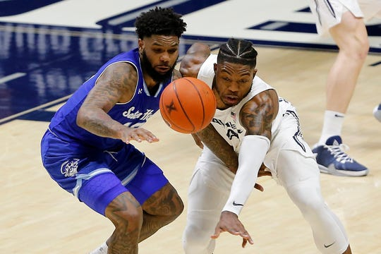 Xavier Musketeers forward Tyrique Jones (4) swipes the ball away from Seton Hall Pirates guard Myles Powell (13) in the second half of the NCAA Big East conference game between the Xavier Musketeers and the Seton Hall Pirates at the Cintas Center in Cincinnati on Wednesday, Jan. 8, 2020. Xavier lost 83-71 in the conference matchup.