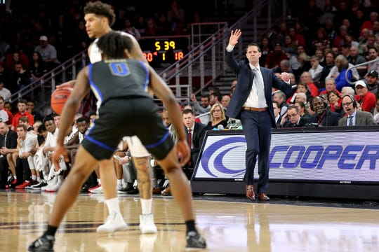 Cincinnati Bearcats head coach John Brannen instructs team during a first-half offensive possession in an NCAA men's basketball game against the Tulsa Golden Hurricane, Wednesday, Jan. 8, 2020, at Fifth Third Arena in Cincinnati.