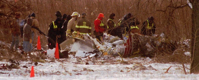 Jan. 10, 1997: Investigators look over the wreckage of Comair Flight 3272 near Monroe, Michigan. The airplane, on a flight from the Cincinnati area, crashed about 18 miles short of Detroit Metropolitan Airport, killing all 29 aboard.