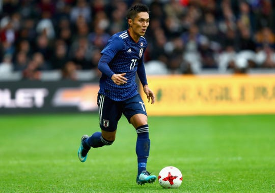 Pictured is Yuya Kubo of Japan in action during an international friendly match between Brazil and Japan at Stade Pierre-Mauroy on Nov. 10, 2017 in Lille, France.